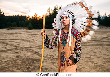 Young American Indian woman in traditional costume