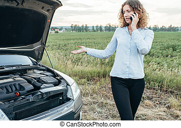 Woman calls to emergency service, broken car - Young woman...