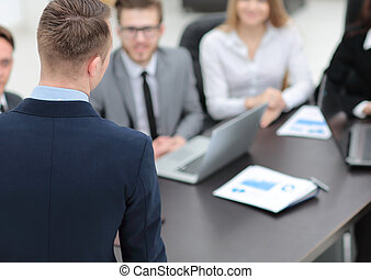 blurred image of business team at a Desk - business...