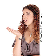 Lovely young woman blowing a kiss - A beautiful young...