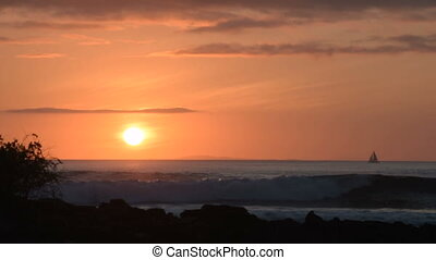 Sail boat and waves on beach landscape at sunset - Beautiful...