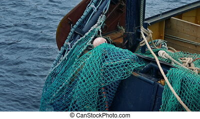 Fishing Nets On The Side Of Boat - Closeup of nets over the...