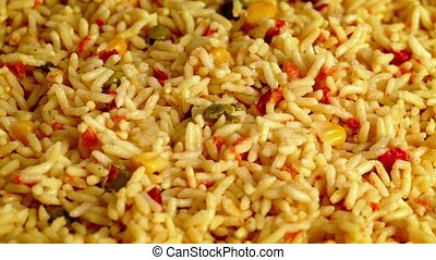 Flavored Rice And Vegetable Mixture Rotating Closeup -...