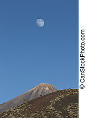 Moon over Mount Teide or, in Spanish, Pico del Teide, the...