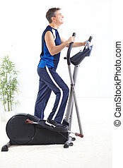 Gym and Fitness - Gym Fitness Smiling man working out...