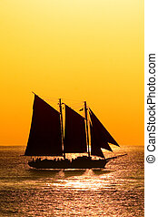 Sailboat in sunset - Sailboat against a beautiful sunset in...
