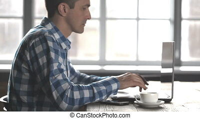Man working on the laptop