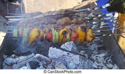 Barbecue with Delicious Grilled Meat and Vegetables Cooked...