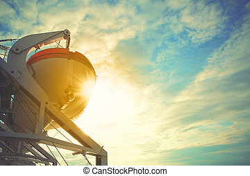Lifeboats on a cruise ship. Filtred image, copyspace...