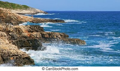 Rocky shore of the Adriatic sea after storm with large waves