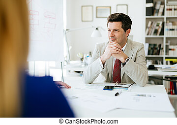 Company director sitting at table