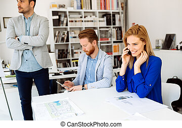 Business people using devices - Business people using phones...