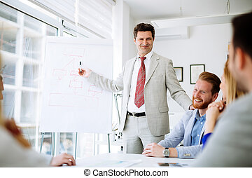 Cheerful satisfied director holding a presentation