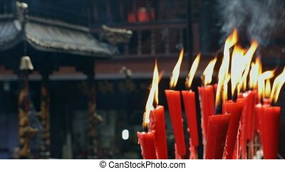 Candles at taoist shrine burning slowly - Red Candles at...