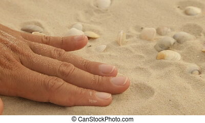 Gold wedding rings in the sea sand