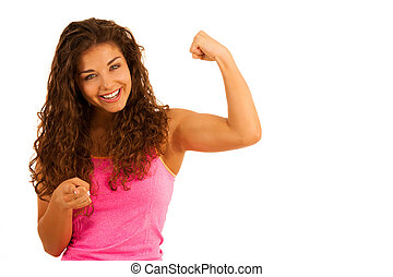 Active young sporty fit woman gesture power with her arms up...