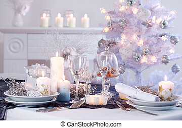 Place setting for Christmas in white with white Christmas...