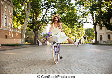 Happy lady outdoors on bicycle. Looking camera. - Picture of...