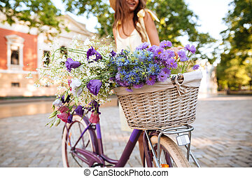 Cropped image of young lady on bicycle.