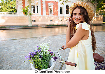 Happy lady outdoors on bicycle. Looking camera. - Image of...