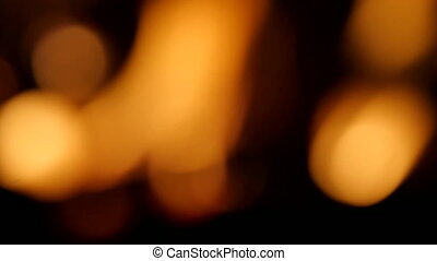 Intense of flames blazing in fireplace, abstract view out of...