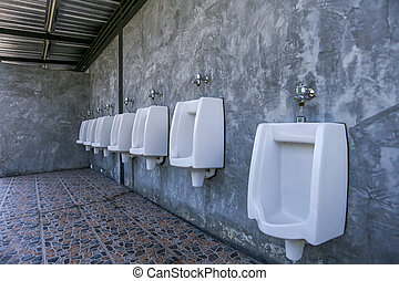 urinal row in a public restroom