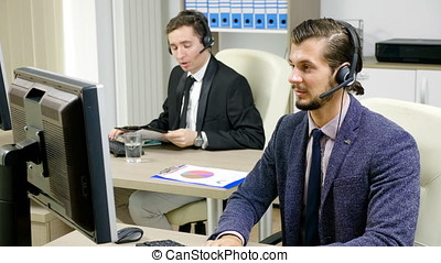 Company representative using headset to talk on the hot line...