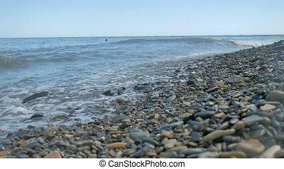 Pebble beach waves sea. Stone beach ocean nature the sea...