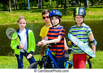activities in the park - Group of cheerful children resting...