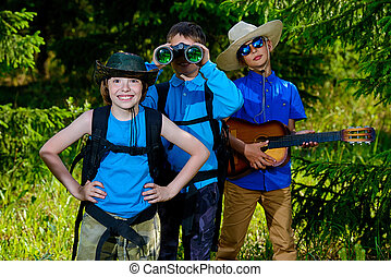 friends on holidays - Three boys friends go hiking with...
