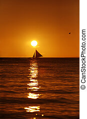 Drifting boat on a sunset. Coast of the Pacific ocean....