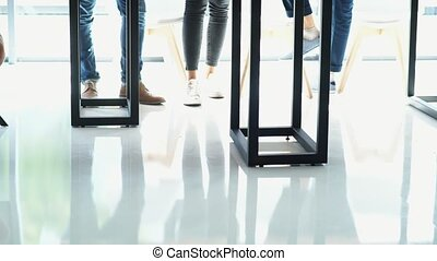 Low angle of a young people standing in the cafe