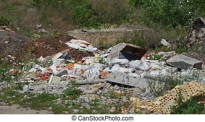 Garbage dump ecology - A lot of garbage lies on the nature....
