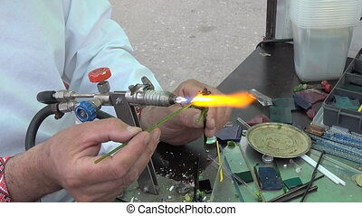 Lampworking. The artist makes jewelry. - Lampworking. The...