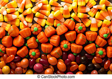 Candy corn and pumpkin Halloween background overhead shot