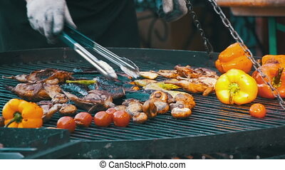 Preparing Meat and Vegetables on the Grill. Slow Motion in...