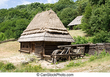 Old watermill - Ancient wooden ukrainian watermill amide the...