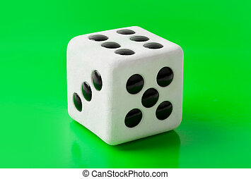 Gambling dice on green background