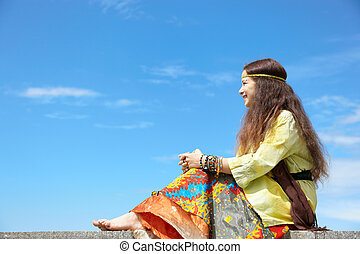 Hippie woman - young female on blue sky background,...