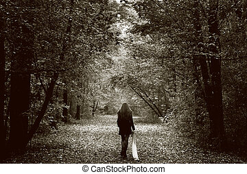 Lonely sad woman on the wood road - Solitude concept -...