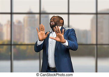 Business man put his hands forward. Black manager with...