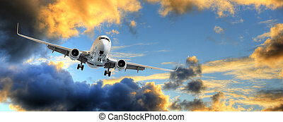 Panorama of airplane in sunset sky - Flying away: panorama...