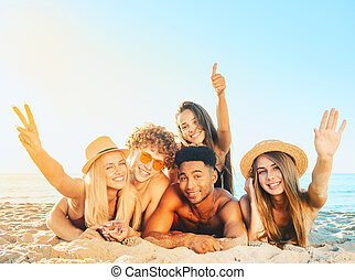 Group of friends having fun on the beach - Group of friends...