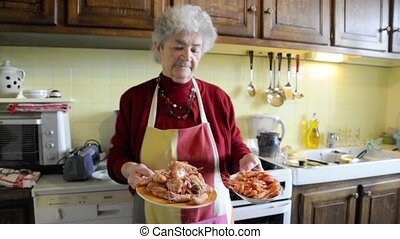 Grandmother cooking seafood - Old senior woman presenting...