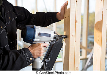 Cropped Image Of Male Carpenter Drilling Wood