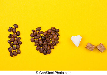 Coffee Cup beans in the form of heart onyellow background....