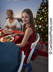 Teenage girl with family in christmas time