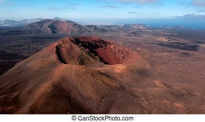 Flying over volcano near Timanfaya National Park, Lanzarote,...