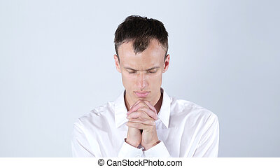Humble Young Businessman Praying to God