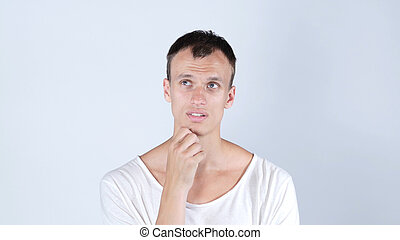 Thinking positive young man portrait. Isolated studio portrait